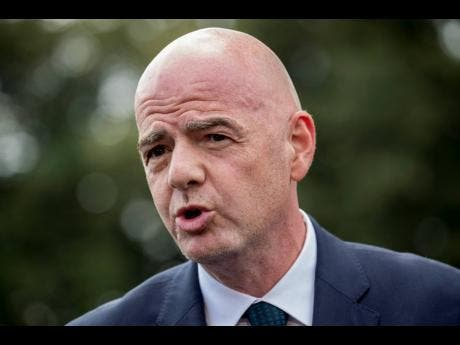 In this Monday, September 9, 2019 file photo, FIFA President Gianni Infantino speaks to members of the media on the South Lawn of the White House in Washington.
