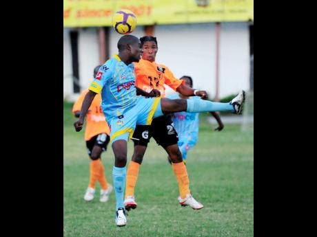 In this file photo from December 2010, Kenardo Forbes (left), then of Waterhouse FC, contests a header with Tivoli Gardens' Shawn McKoy during their Premier League match at the Edward Seaga Sports Complex.