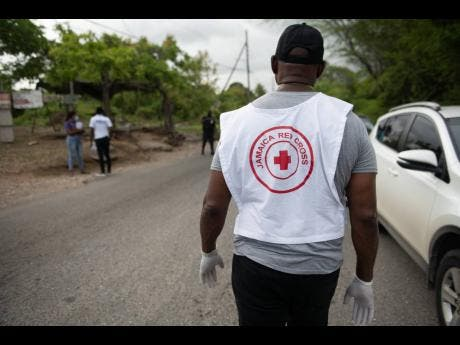 A member of the Jamaica Red Cross prepares to distribute supplies to residents.