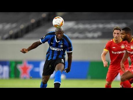 Inter Milan's Romelu Lukaku (left) controls the ball during the Europa League quarter-final match against Bayer Leverkusen at Düsseldorf Arena, in Düsseldorf, Germany, yesterday.