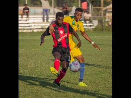 Arnett Gardens' Paul Wilson (left) escapes from Vere United's Javeir Brown during their Red Stripe Premier League game at the Wembley Centre of Excellence in Hayes, Clarendon on Sunday, December 8, 2019.