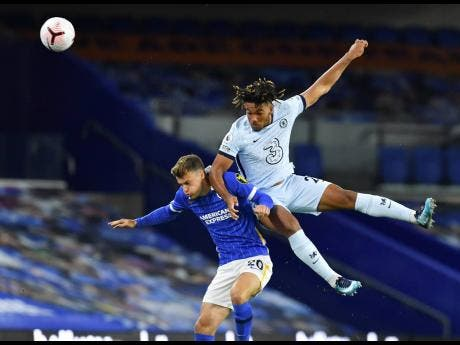 Chelsea's Reece James (right) and Brighton's Solly March contest for the ball during their English Premier League match at Falmer Stadium in Brighton, England, yesterday.