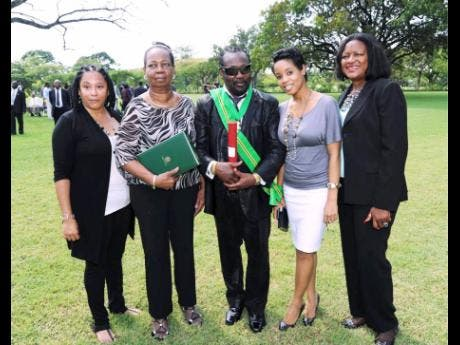 Frederick 'Toots' Hibbert (centre) received the Order of Jamaica in 2012. Here he shares the moment with members of his inner circle (from left) public relations agent Andrea Davis; his wife Doreen Hibbert; granddaughter Cressida Rattigan; and family friend Pamela Watson.