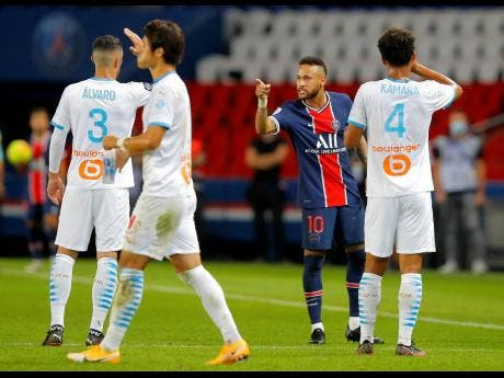 PSG's Neymar argues with Marseille's Alvaro (left) during their French League One match at the Parc des Princes in Paris, France on Sunday.