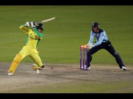 Australia's Alex Carey is stumped by England's wicketkeeper Jos Buttler during the second ODI cricket match at Old Trafford in Manchester, England, on Sunday, September 13.
