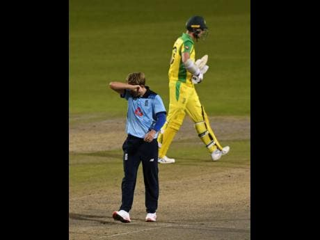 England's Sam Curran (left) reacts after bowling a delivery during the second ODI match against Australia at Old Trafford in Manchester, England, on Sunday, September 13.