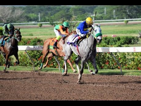 ENUFFISENUFF (right), ridden by Dane Nelson, on the way to winning the eighth race at Caymanas Park on Sunday, July 26.