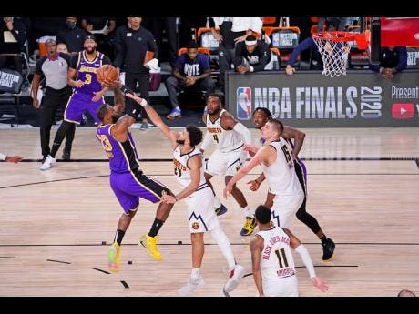 Los Angeles Lakers' LeBron James (23) shoots against the Denver Nuggets during the second half of an NBA conference final playoff basketball game Saturday, September 26, 2020.