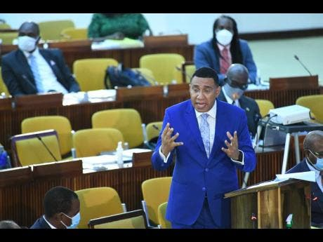Prime Minister Andrew Holness speaking at the sitting of the House of Representatives at the Jamaica Conference centre on Tuesday.