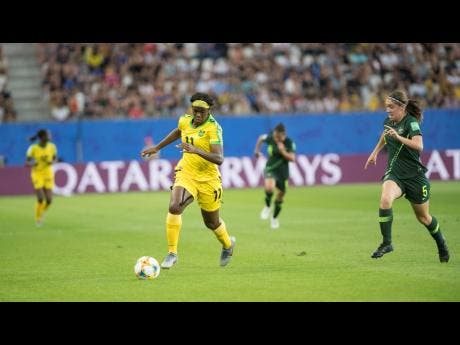 File Khadija Shaw (left) dribbles taway from Australia's defender Karly Roestbakken in  their FIFA Women's World Cup group-stage match on June 18, 2019.
