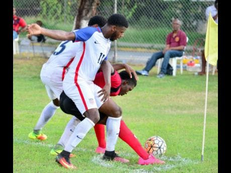 File Zyen Jones of the USA (centre) challenges Arnett Gardens' Anthony Thompson for the ball in an Under-20 match at Jamaica College on November 4, 2016.