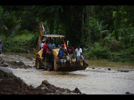 Residents use a tractor to get across the river.