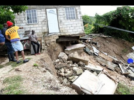 A section of a house that collapsed during a landslide in Shooters Hill during heavy rains on Sunday.