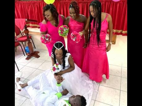 Bridesmaids (from left) Octavia Headley, Shamair James (maid of honour) and Jaina Henry, look on as their friends Anishka and Davion 'Nah Bade' Hodges have a little fun inside the Calvary United Worship Centre.
