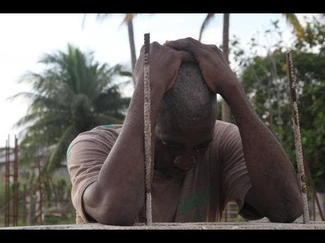 The loss of Oshane Banton is too much for his grandfather, Denham Davidson. Inset: Oshane Banton.