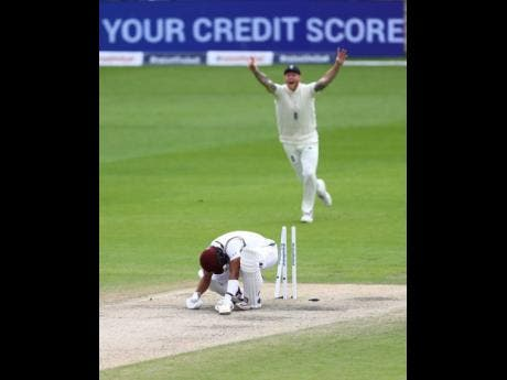 West Indies' Shai Hope is bowled out by England's Stuart Broad during the last day of the second cricket Test match between England and West Indies at Old Trafford in Manchester, England, Monday, July 20, 2020.