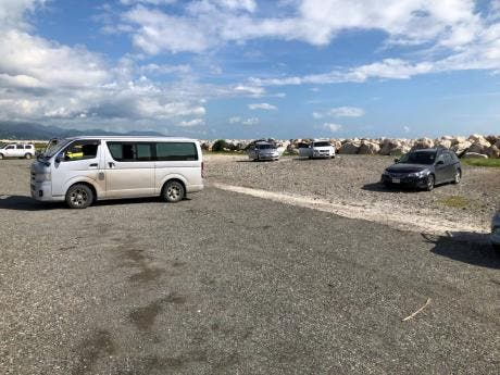 Vehicles parked on the Palasados strip by drivers, some of whom are hoping for an opportunity to earn some cash.