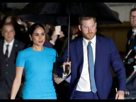 FILE  Prince Harry and Meghan, the Duke and Duchess of Sussex.