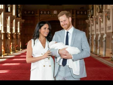 FILE - In this Wednesday May 8, 2019 file photo Britain's Prince Harry and Meghan, Duchess of Sussex, pose during a photocall with their newborn son Archie, in St George's Hall at Windsor Castle, Windsor, south England.