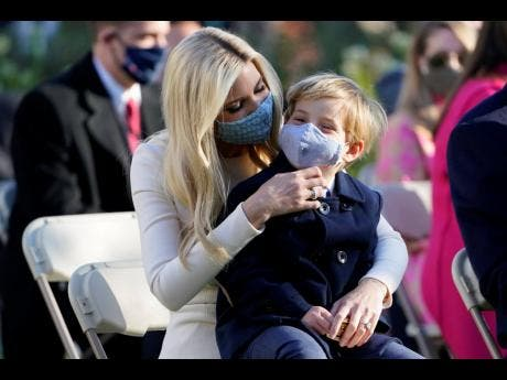 Ivanka Trump, assistant to the President, sits with her son Theodore Kushner, as they wait for President Donald Trump to pardon Corn, the national Thanksgiving turkey, in the Rose Garden of the White House, Tuesday, Nov 24, 2020, in Washington. (AP Photo/Susan Walsh)