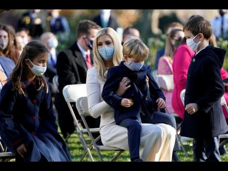 Ivanka Trump, assistant to the President, sits with her son Theodore Kushner, centre, daughter Arabella Kushner, left, and son Joseph Kushner, right, as they wait for President Donald Trump to pardon Corn, the national Thanksgiving turkey, in the Rose Garden of the White House, Tuesday, Nov 24, 2020, in Washington. (AP Photo/Susan Walsh)