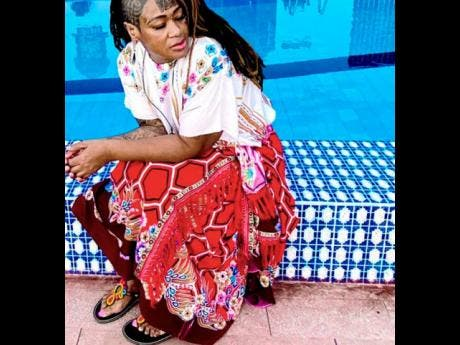 A'mari has ditched her Western clothing for colourful African garb.