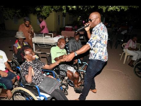 In this 2019 photo, George Nooks is seen performing for residents of the Golden Age Home.