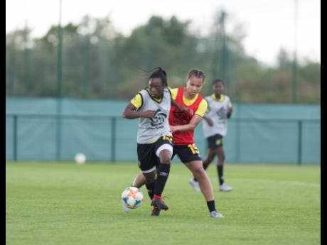 File Tiffany Cameron dribbles away from Toriana Patterson during a Reggae Girlz training session in France on June 10, 2019.