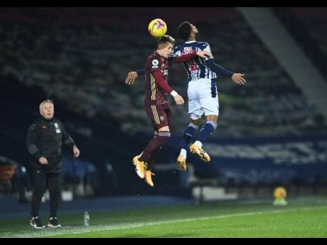 West Bromwich Albion's Darnell Furlong ( right) and Leeds United's Ezgjan Alioski challenge for the ball during their English Premier League match United at The Hawthorns stadium, West Bromwich, England, yesterday.