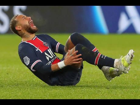 PSG's Neymar falls in pain during the League One football match between Paris Saint Germain and Lyon, at the Parc des Princes stadium in Paris, France, Sunday, December 13, 2020.