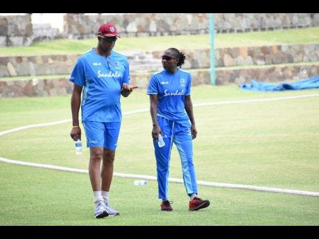 West Indies women's head coach Courtney Walsh converse with Stafanie Taylor during a training session in last year.