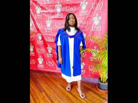 Rosemarie Scott taking her graduation photos.