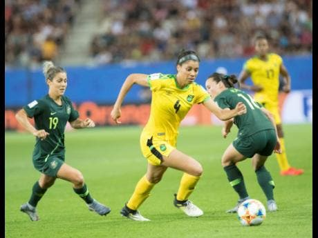 File Jamaica's Chantelle Swaby (right) dribbles away from Australia's Katrina Gorry in a FIFA Women's World Cup match.