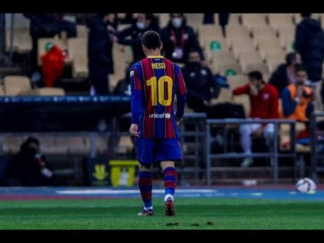 Barcelona's Lionel Messi walks out of the pitch after being shown a red card during the Spanish Supercopa final match against FC Barcelona at La Cartuja stadium in Seville, Spain, on Sunday.