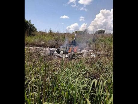 Scene of a plane crash which killed four football players in Brazil yesterday.
