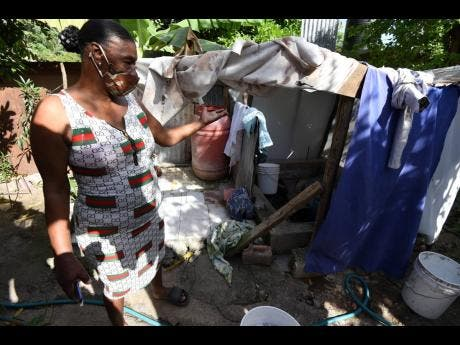 Smith shows her makeshift bathroom and toilet, which have drawn the ire of her neighbours.