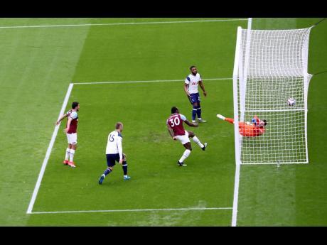 West Ham's Michail Antonio (third left) scores his side's opening goal yesterday.
