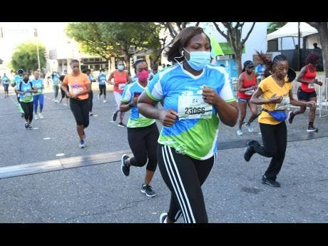 Participants take part in the Sagicor SIGMA Corporate 5K run yesterday in New Kingston.