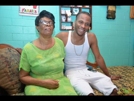 Mama Christie and Dexta Daps.