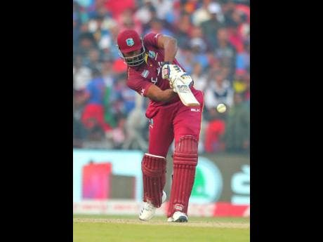 File West Indies captain Kieron Pollard bats during the third and final One-Day International  match of the series against  India in Cuttack, India.