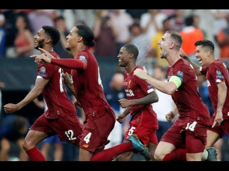 Liverpool players celebrate after winning the UEFA Super Cup match against Chelsea at Besiktas Park, Istanbul, on Thursday, August 15, 2019.
