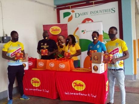 Dairy Industries presents Tastee cheese products to members of the Waterhouse Football Club at Dairy Industries, 111 Washington Boulevard, yesterday.