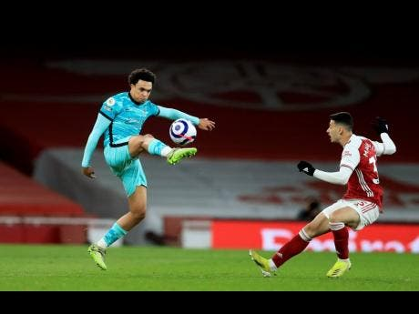 Arsenal's Gabriel Martinell (right) challenges Liverpool's Trent Alexander-Arnold during their English Premier League match at the Emirates Stadium in London, England, on Saturday, April 3.