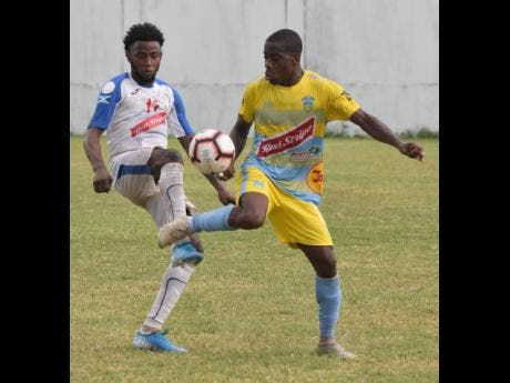File Photos Wasterhouse's Tremaine Stewart stylishly controls the ball while being challenged by Portmore United's Tevin Shaw during a Red Stripe Premier League match on November 10, 2019.