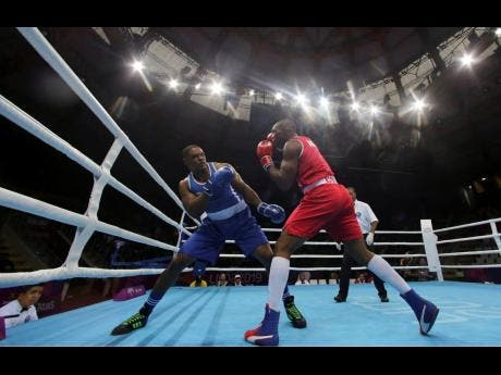 File Cristian Salcedo of Colombia (right) throws a punch to Ricardo Brown of Jamaica during the second round of their men's heavy 91 kg semi-final boxing match at the Pan American Games in Lima, Peru, Tuesday, July 30, 2019.