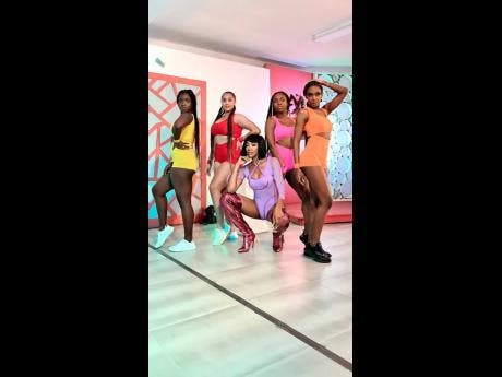 D'Angel (centre) with dancers on the set of the music video for her new single, 'Gud Gyal'.