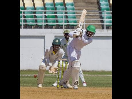 Guyana Jaguars batsman Chandrapaul Hemraj hits through the on side during his half century against the Jamaica Scorpions at the Trelawny Stadium on Saturday, November 30, 2019.