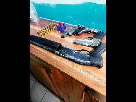 The three illegal guns and ammunition seized on Wednesday by the security forces in Woodside, Clarendon.