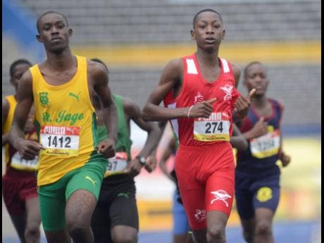 File Photos Alex Taylor of St Jago High School(left) fights off the challenge of Shacquille Gordon of Charlemont High School to win his heat of the boys class three 800 meter during day one of the ISSA/GraceKennedy Boys and Girls' Athletics Championships on Tuesday March 26, 2019.