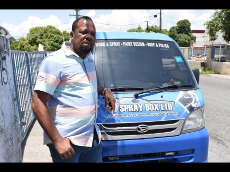 Wayne Green, director of the Spray Box, an auto body repair shop.